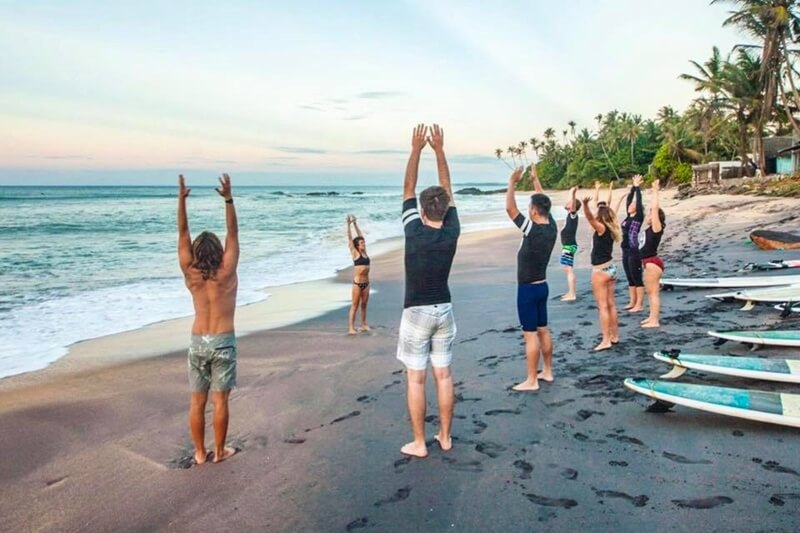 Pre-surf yoga session on the beach with Talalla Surf in Sri Lanka